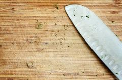 ussed knife on rustic kitchen table - stock photo