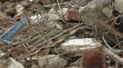 Entangled mess of metal and rocks Stock Footage