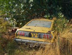 Vintage car wreck  in greece Stock Photos