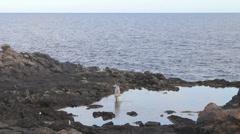 A woman catch crab , Fuerteventura. Stock Footage