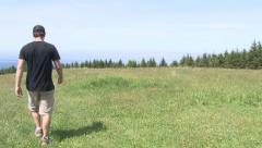 Person Walking Through Grassy Field 1 Stock Footage