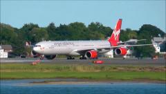 Virgin Atlantic airplane arrival Stock Footage