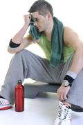 sportsman relaxing and drinking water - stock photo