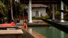 Tanned Woman Enjoying in Luxurious Pool in Sea View Resort. Thailand. Koh Samui. Stock Footage