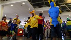 Brazilian father and son dance samba before the match Brazil versus Croatia Stock Footage
