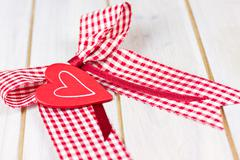 Red ribbon with heart Stock Photos