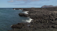The coast of a volcanic island of the Galapagos. Stock Footage