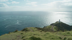 Cape Reinga high and wide shot 2 oceans meet Stock Footage