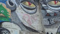 Street art by unidentified artist, Colorful graffiti on a concrete wall.HD Stock Footage