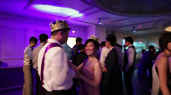 Prom king and prom queen dancing highschool party Stock Footage