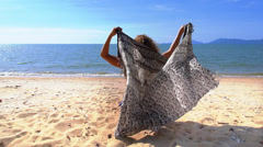 Nude Woman Relaxing on the Beach with Pareo. Slow Motion. Stock Footage