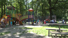 Timelapse, Playground with happy children's in middle of nature, Summer holiday - stock footage