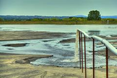 Toxic water stems from the pipe polluting the lake Stock Photos