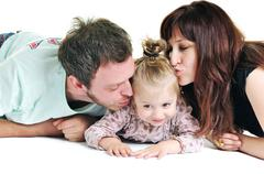 Happy young family together Stock Photos