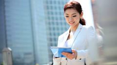 Ethnic Asian Japanese Woman Business Suit Outdoors Wireless Cloud Hotspot - stock footage