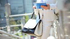 Female Asian Japanese Business Finance Tokyo City Tablet Hotspot - stock footage