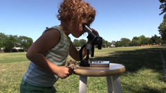 Microscope, early educational exploring , park Stock Footage