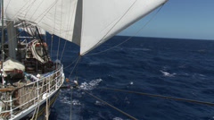 A large ship (a clipper) sailing on open sea, filmed from the stern of the ship, Stock Footage