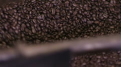 Factory coffee roasting machine in operation, turning and stirring roasted beans Stock Footage