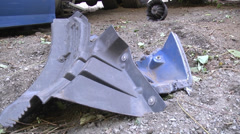 Closeup wreckage cam tilts up reveals full trailer twisted wreck Stock Footage