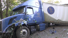 Tractor trailer wrecked pan of full rig at scene MS Stock Footage