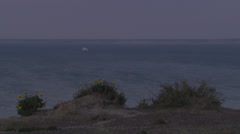 A ship sailing along the shore at dusk. Stock Footage