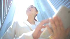 Ethnic Asian Japanese Woman Suit Outdoors Wireless Cloud Hotspot Sun Lens Flare - stock footage