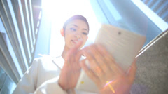 Young Ethnic Asian Japanese Businesswoman City Downtown Tablet Device - stock footage