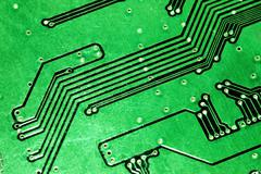 Green computer board with chips and components. - stock photo