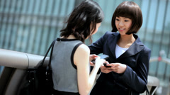 American Asian Japanese Girls Business Financial Executive Smart Phone Sharing - stock footage