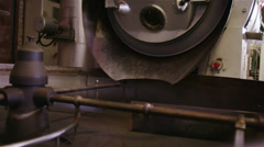 Factory machine in operation, turning and stirring roasted coffee beans - stock footage
