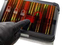 Unlocking online system concept with hand wearing black glove pointing a tabl Stock Photos