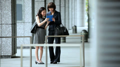American Asian Japanese Girls Business Financial Executive Mini Tablet Device - stock footage