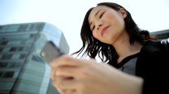 Young Ethnic Asian Japanese Businesswoman City Downtown Smart Phone Device Stock Footage