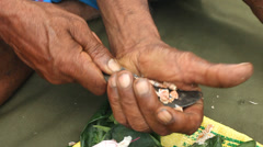 Close up of man preparing paan or betel nut or areca nut mix. Stock Footage
