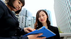 Females Asian Japanese Business Finance Tokyo City Tablet Hotspot - stock footage