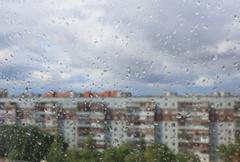 Drops of a rain on a window pane - stock illustration