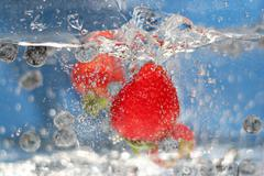 Stock Photo of Red Strawberries Splash