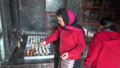 Tibetan buddhist woman prayers in Katmandu Swayambhunath stupa. Stock Footage