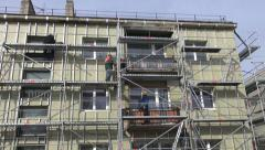 Workers fixing thermal insulation material rock wool on house wall Stock Footage