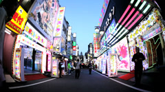 Tokyo Neon City walk illuminated nightlife tourist entertainment Shinjuku Japan Stock Footage