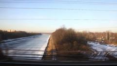 View from train Window, crossing bridge, early spring with snow Stock Footage