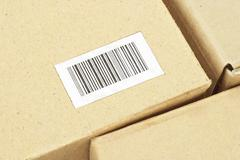 Bar code label on carton box Stock Photos