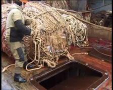 Fishing vessel in the fishery, fishermen pulling trawl - 04 Stock Footage