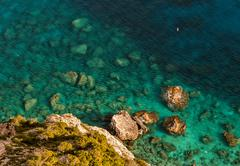 Rocks and the shallow water Stock Photos