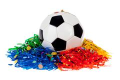 Stock Photo of soccer ball: ball with poms and confetti