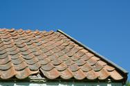 Stock Photo of broken tiled roof