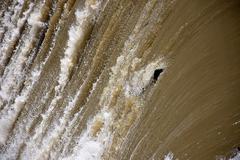 Log Going Over Waterfall Stock Photos