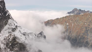 Stock Video Footage of Mountains and thick clouds moving among sharp, rocky peaks