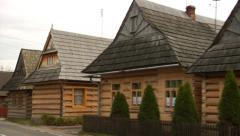 Stock Video Footage of 200 years old wooden log houses in Chocholow, Poland, with shake roofs.
